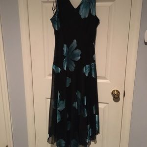 Black dress with green floral print